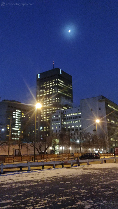 Early evening moon over downtown Winnipeg, Manitoba