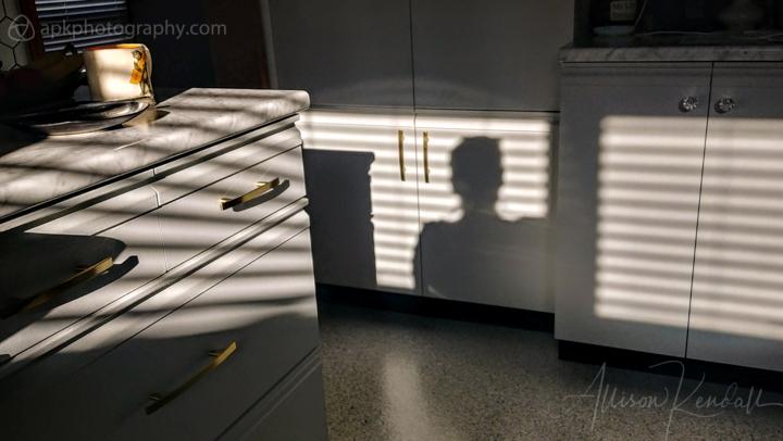 Kitchen shadows, self-portrait in winter light