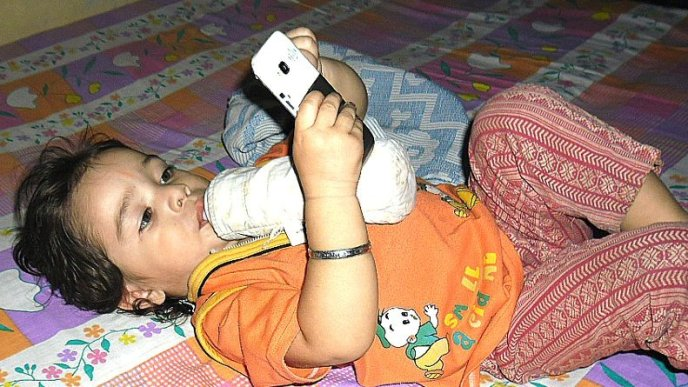 vansh with phone and having milk at same time :p