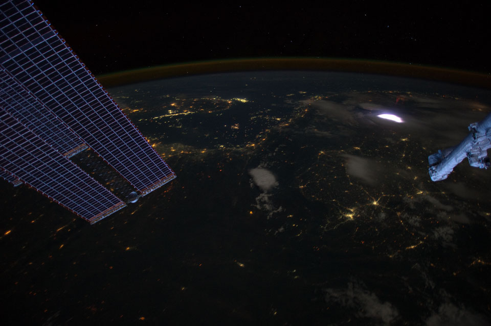 A Dark Earth with a Red Sprite Image Credit: ISS Expedition 31 Crew, NASA