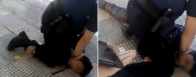 'this-is-not-the-united-states':-spanish-policeman-filmed-kneeling-on-teenager's-neck-for-allegedly-wearing-facemask-the-wrong-way
