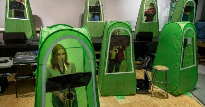 image-shows-school-band-'socially-distanced'-inside-human-tents