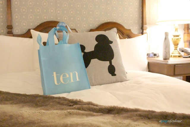 Ten spa bag on bed
