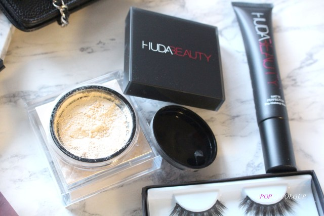 Huda Beauty primer, lashes, and baking powder