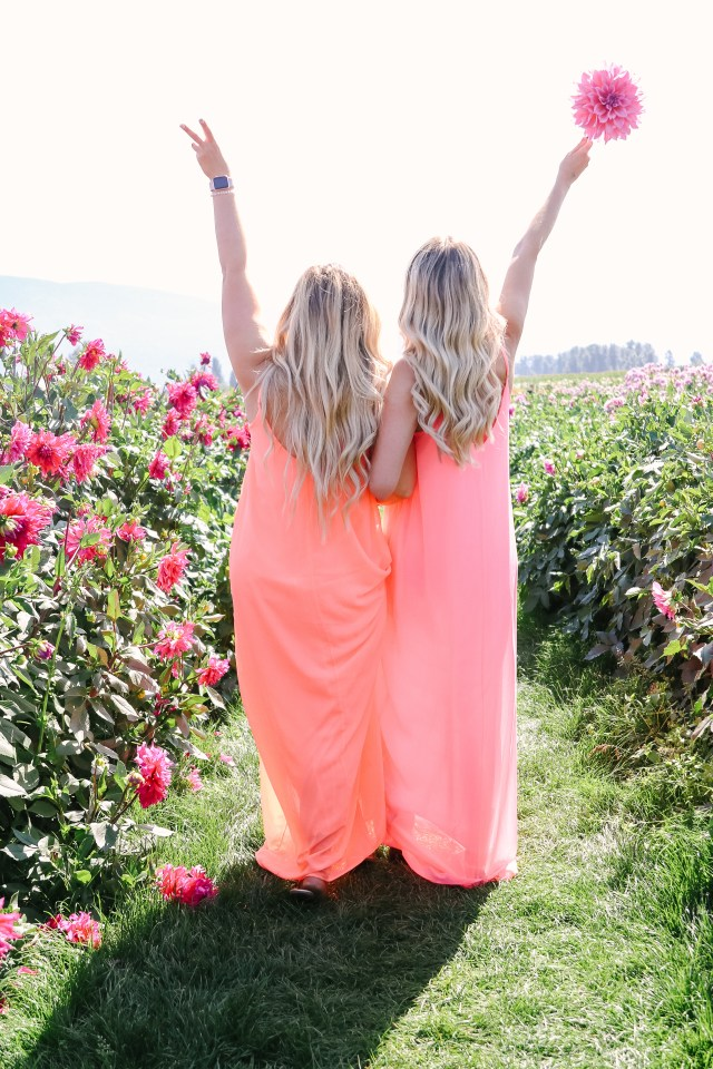 Two girls in flower field wearing neo dresses from Pink Blush
