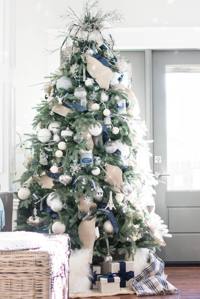 If you've been wondering how to put ribbon on a Christmas tree this way,  don't stress! You don't have to be a professional decorator to achieve this  look. - How To Put Ribbon On A Christmas Tree - A Pop Of Pretty Blog