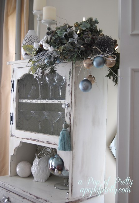 Christmas vignette with bulbs and branches