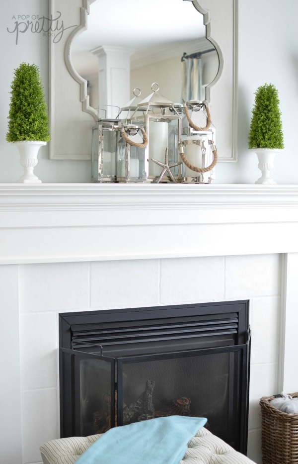 Summer decorating mantel with lanterns