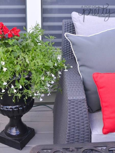 summer decorating - flowers in black urn