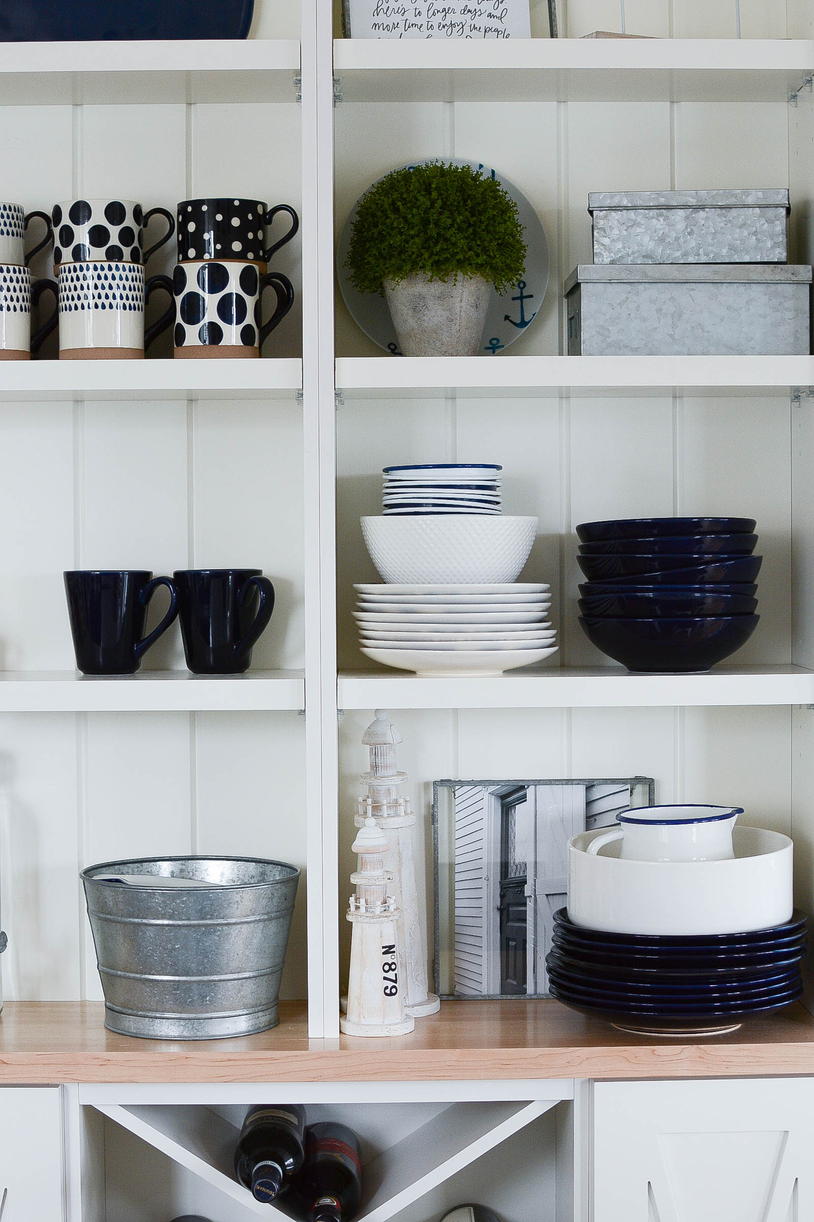 Coastal farmhouse style open shelving in kitchen (nautical style)