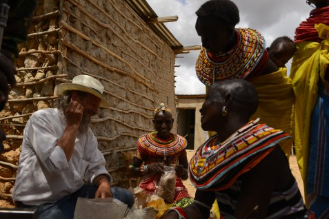 Negotiating a fair price for Frankincense with the Samburu women who are the main collectors of the fragrant resin. The Samburu women were getting a kick and a giggle over my single pierced ear. The Samburu warriors have 2 pierced ears outfitted with plugs. A white man with a single big tunnel was a constant source of entertainment for the tribe and a great icebreaker.