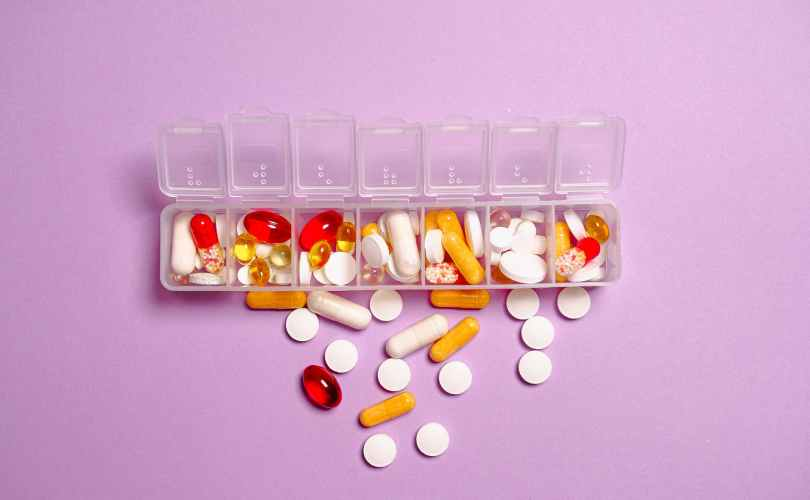photo medication pills on white plastic container