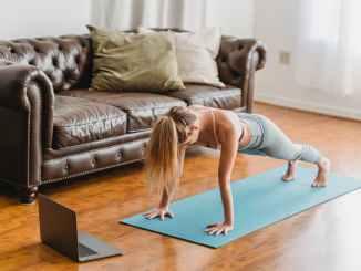 slim woman doing plank exercise