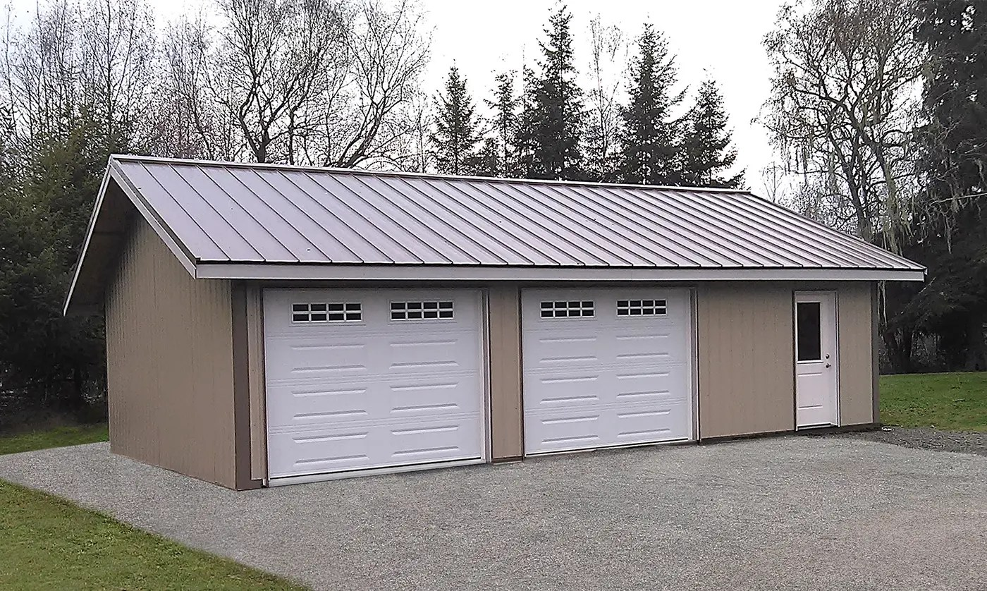 Two-car garage with metal roofing and energy-efficient access door