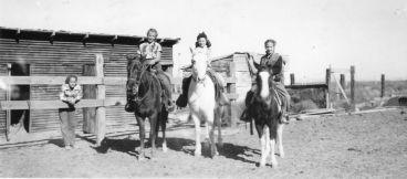 Sue on fence, Grace on Lady Gardner, Robbie Ramsey on Joe, Rica on Baby, 1950