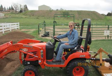 Barb on her tractor, May 18, 2013
