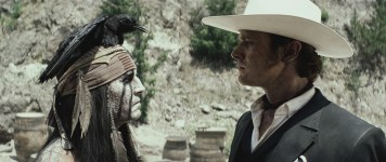 """""""THE LONE RANGER"""" L to R: Johnny Depp as Tonto and Armie Hammer as The Lone Ranger ©Disney Enterprises, Inc. and Jerry Bruckheimer Inc. All"""