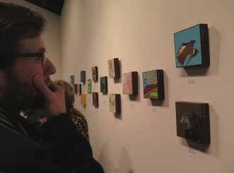 Devin looking at art.