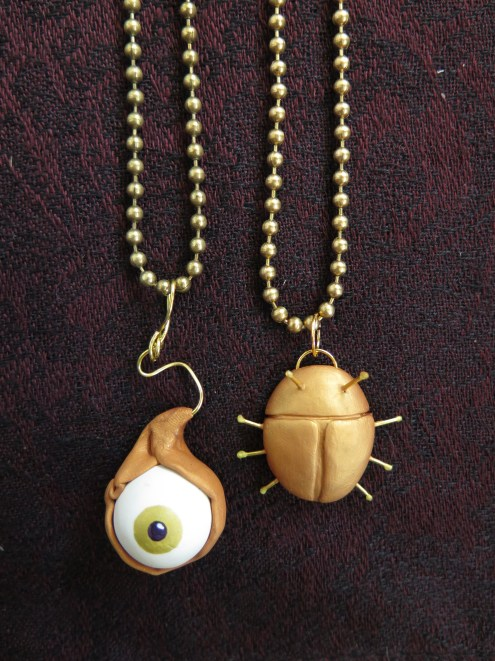 Eyeball and beetle necklaces close-up
