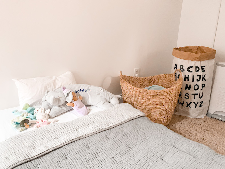 Toddler bed with a baby pillow and baby crib comforter and quilt