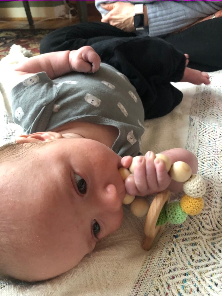 Support your 3-month-old's development with small toys for them to hold and chew!