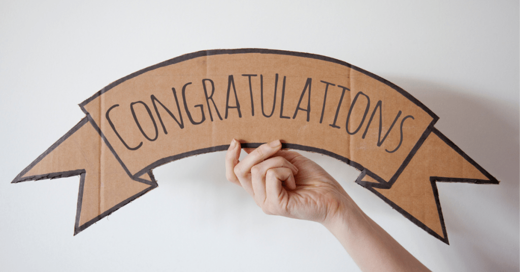 An affordable congratulations sign from reusable materials. A household sign to celebrate the end of the school year.