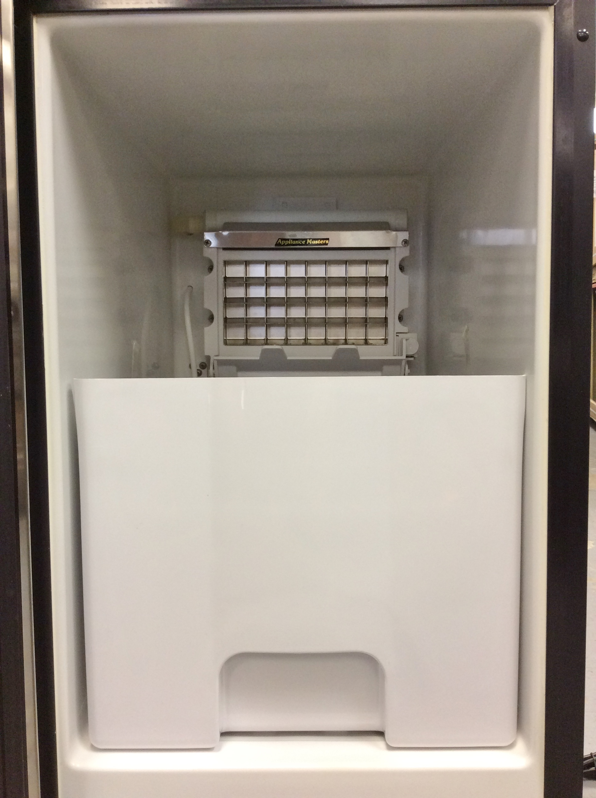hi50ib20ss-inside the Haier Built In Ice Maker.Large Ice Container.See at Appliance Masters