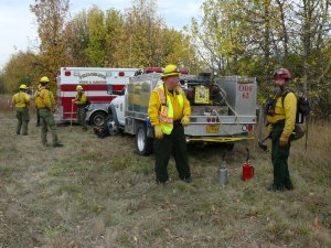 Philomath Fire & Rescue and Oregon Department of Forestry personnel discuss the plan of action for the prescribed burn