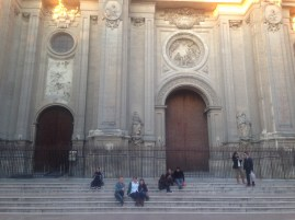On the steps of the cathedral in Granada