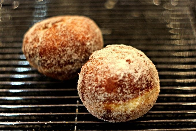 fried jam doughnuts covered in sugar