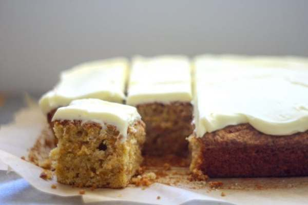 carrot tray bake with cream cheese icing cut into squares