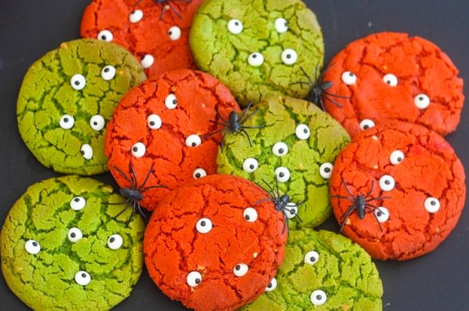 Bright red and green halloween monster cookies with candy eyes