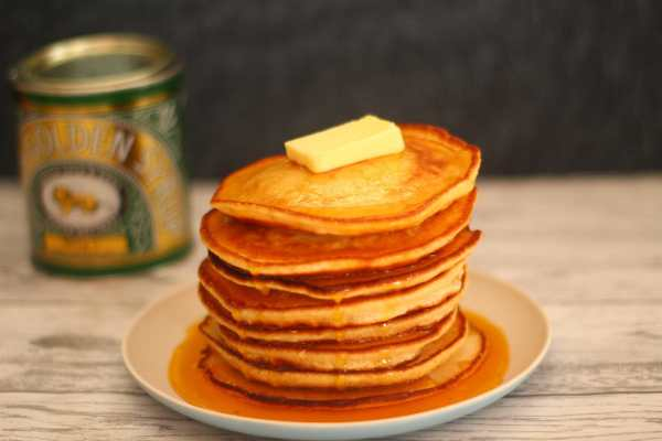 stack of pancakes covered in syrup and butter on a plate