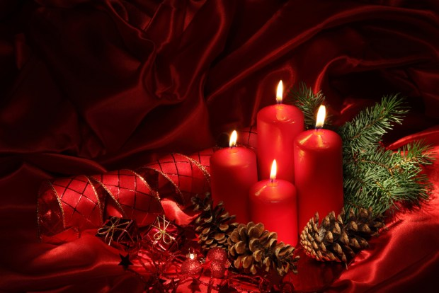 Christmas candles on a red background