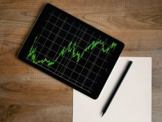 space grey ipad air with graph on brown wooden table