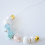 Make this unique and oh-so-pretty wooden bead necklace using nail polish and copper embellishments. A chic and minimal necklace with a subtle style statement.