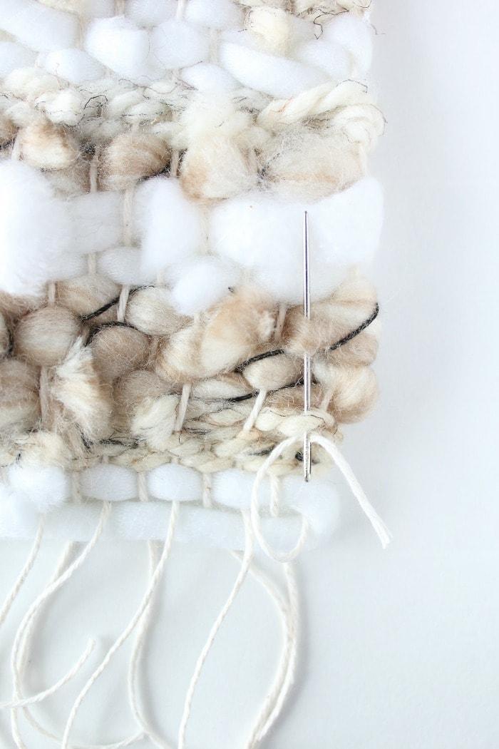 DIY mini framed weaving - weave cotton strands into back side.
