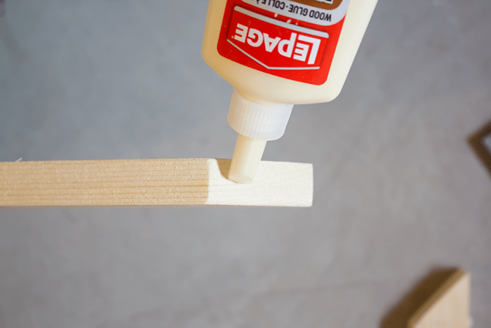 How To Frame a Canvas - glue corners.
