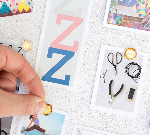How To Make a Vision Board - pin images onto board.