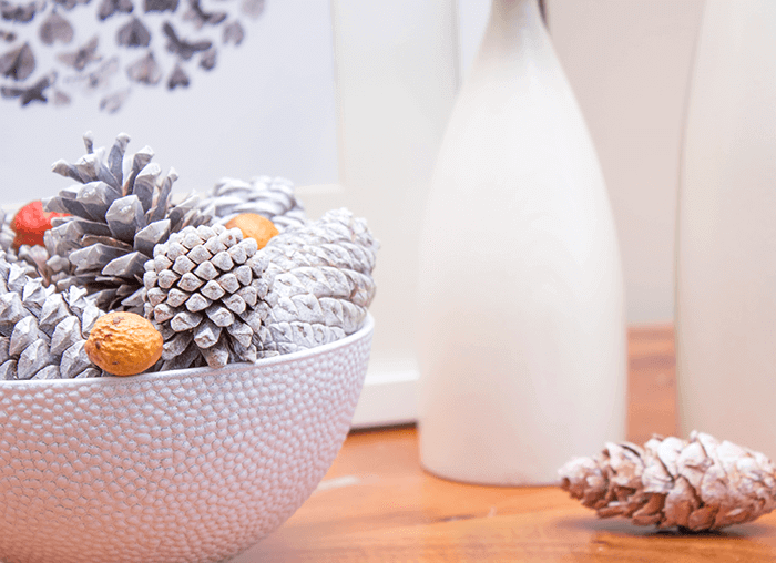 Autumn decorating using a dollar store bowl, spray paint, and pinecones | simple craft idea for fall.