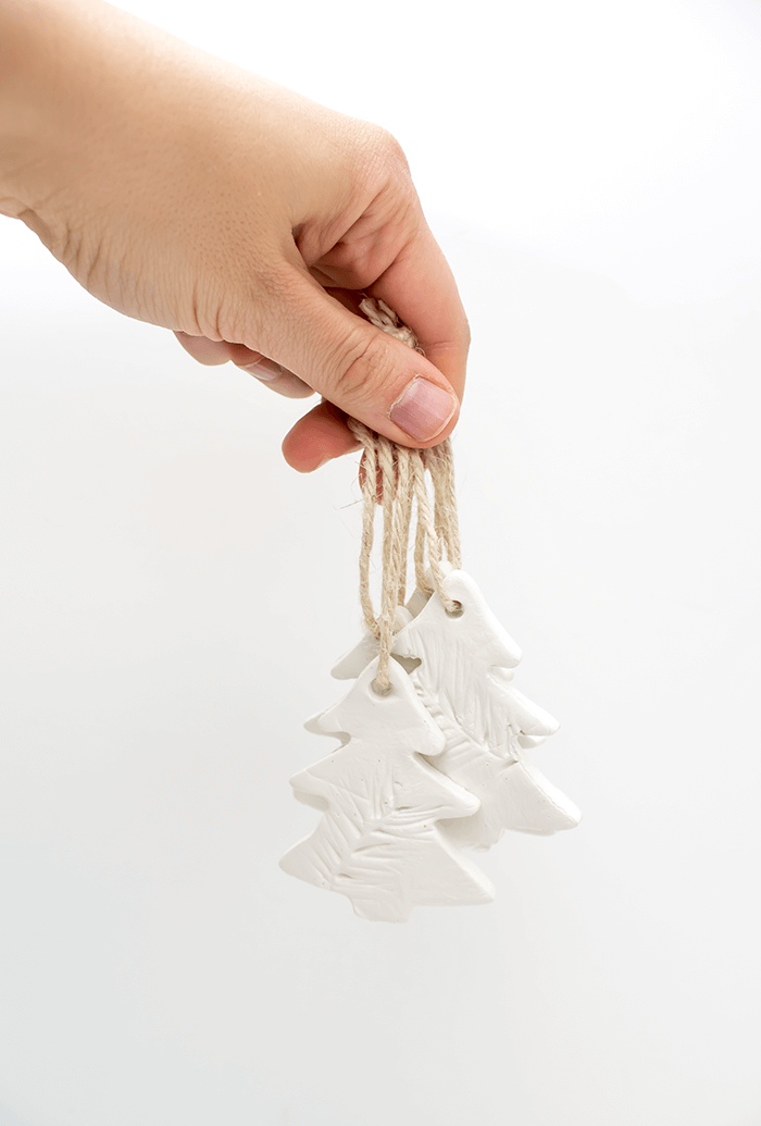 Add jute ribbon to clay ornaments for a rustic touch.