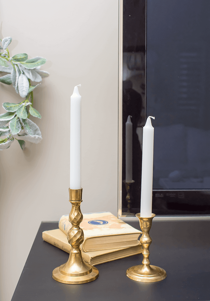 Gold candlesticks and vintage books.