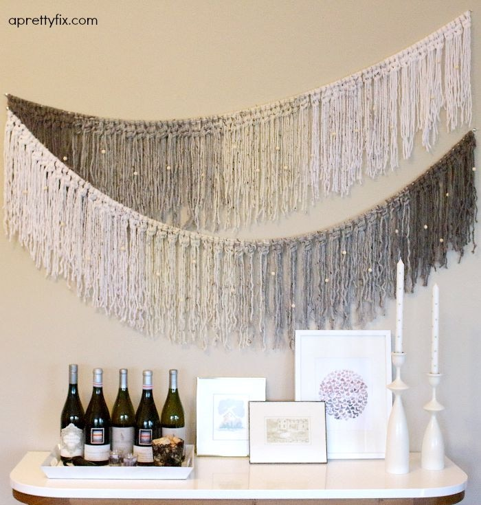 This DIY ombre garland incorporates yarn crafting and macrame to create this lovely wall hanging. Great for seasonal decorating or to add a splash of style to a wall.