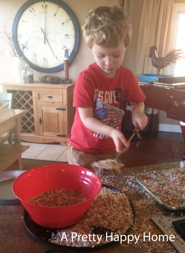 Toddler sensory play with rice and lentils.