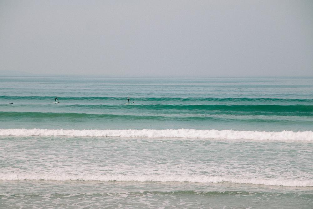 Surfers at Newgale Beach in Pembrokeshire