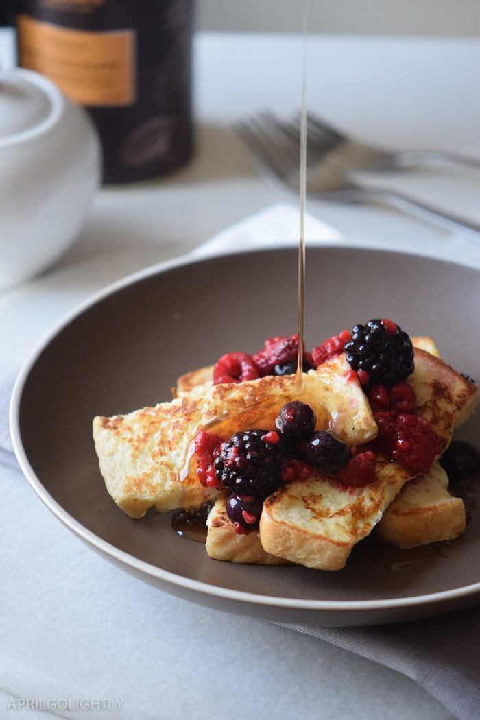 Easy French Toast Sticks recipe perfect for luxurious brunch or breakfast made with fresh fruit like raspberries, blueberries, and blackberries with maple syrup on top