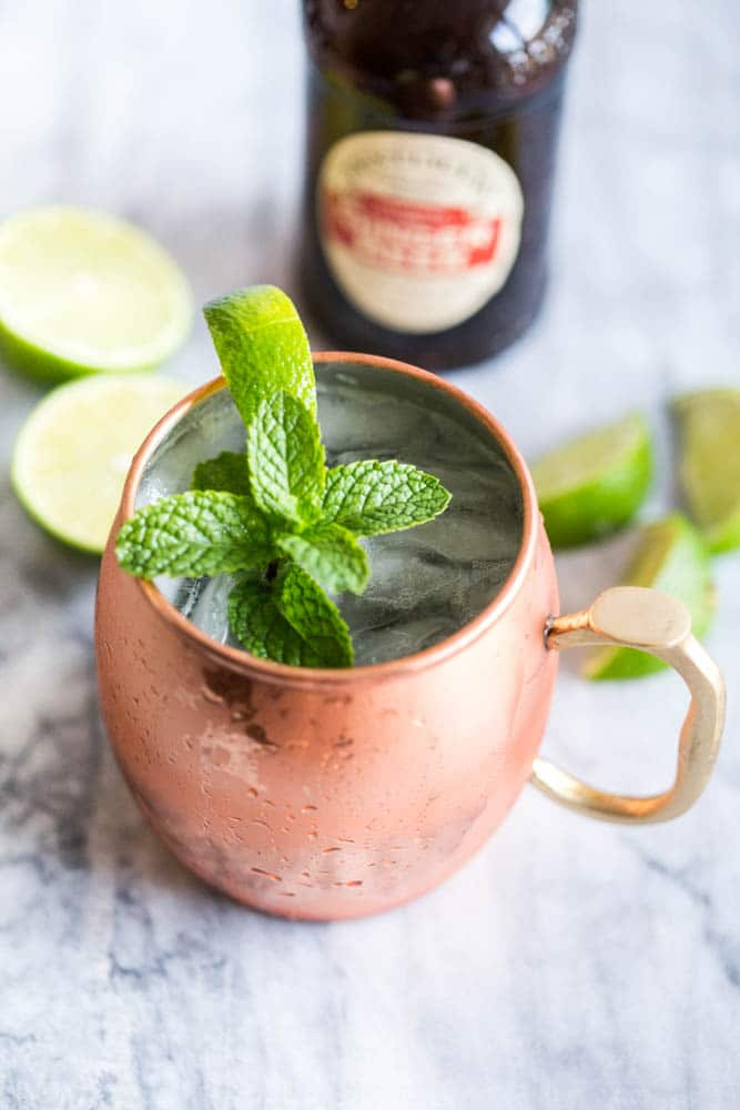 Easy Moscow Mule Cocktail Recipe made in the traditional copper mug made with vodka, fresh lime juice, Ginger Beer, a spring of mint and slice of lime