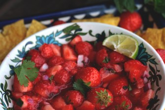strawberry salsa with mint in background