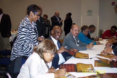 2014 Honorees sign calendars at Opening Luncheon