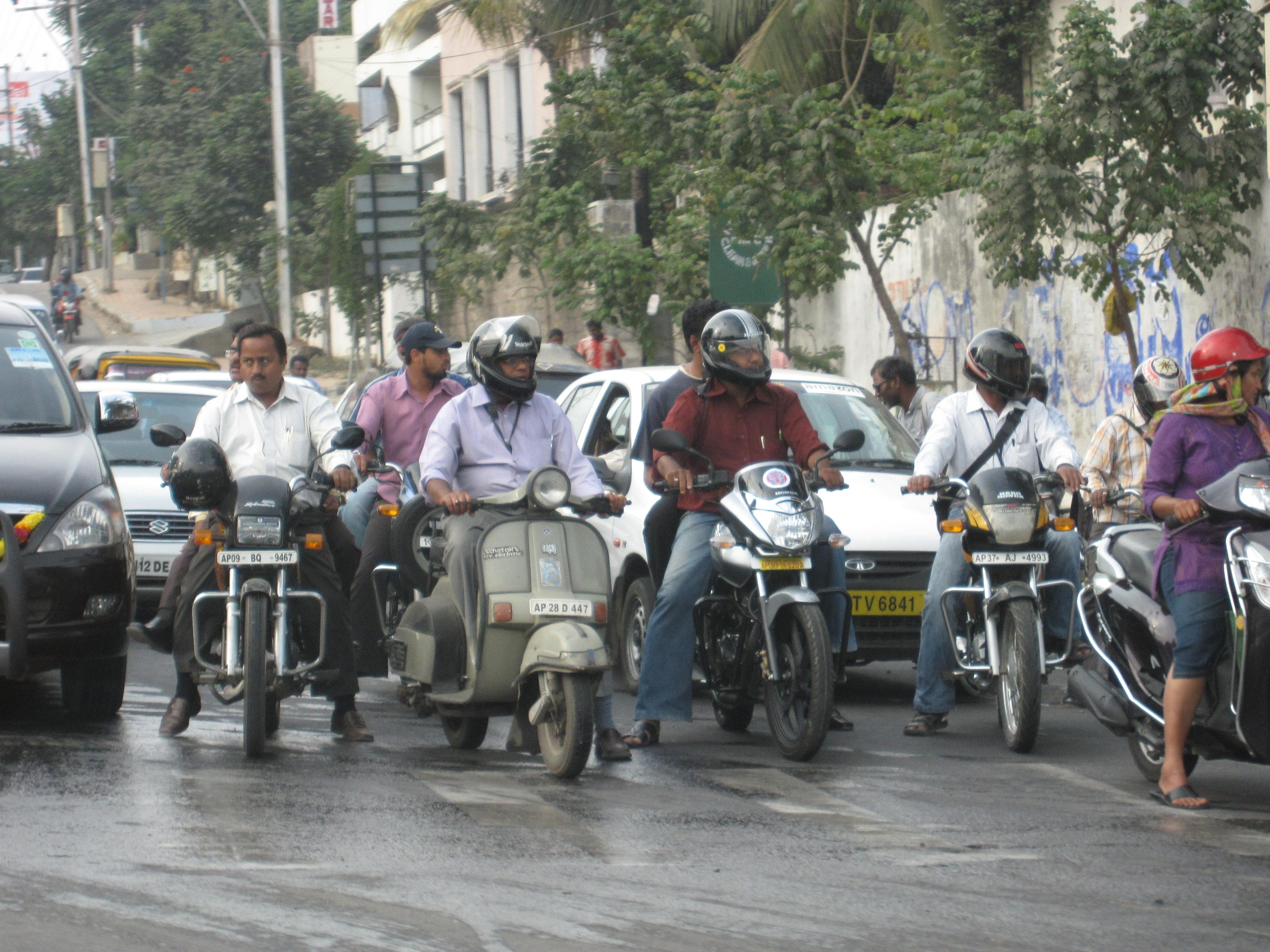 Motorcycle riders generally wearing helmets